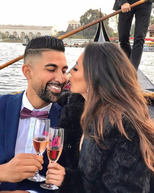Dhar Mann and girlfriend Laura G enjoy a gondola ride and toast champagne